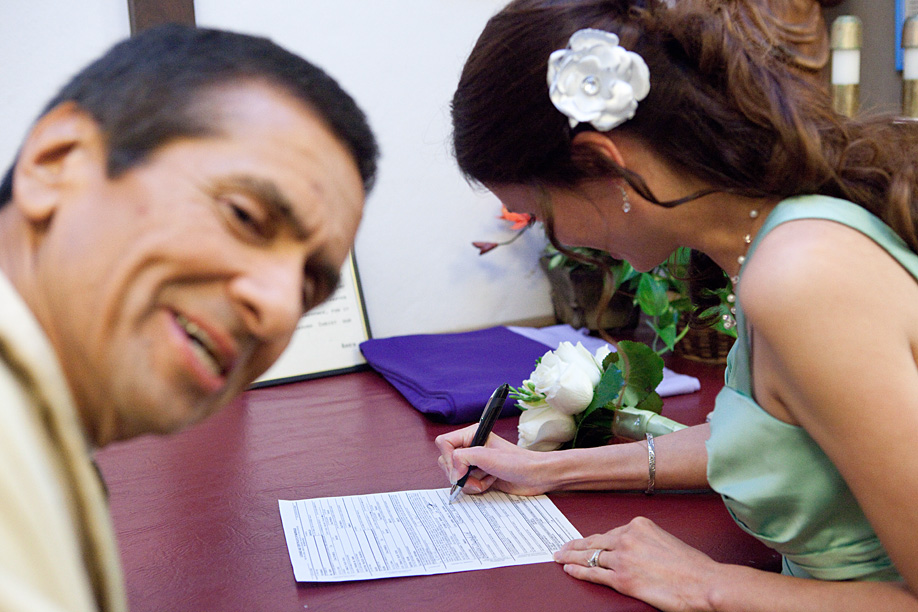 Father John Photobombs Signing the Marriage License
